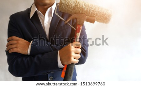 Businessman hold the hammer on white background with copy space for text,Strong tool for strategy and victory concept,weapon of marketing for business idea. stock photo