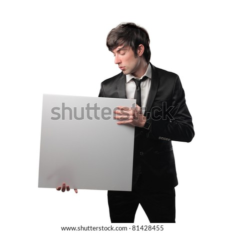 Businessman holding a billboard