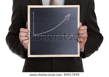 Businessman holding a blackboard with a graph showing a positive trend with space for message