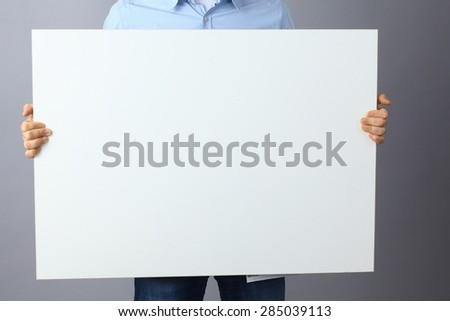 Businessman holding a blank  board . #285039113