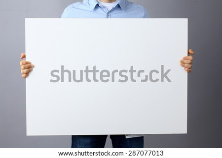 Businessman holding a blank  board . #287077013