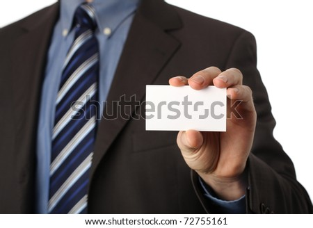 businessman holding a blank business card in his hand