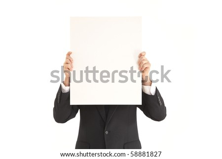 Businessman holding a blank sign in front oh his face