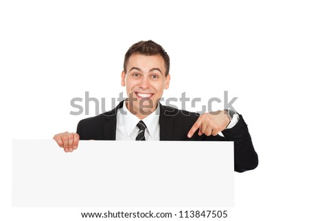 businessman holding a blank white card board, signboard, point finger showing an empty bill board, handsome young business man happy smile, isolated over white background