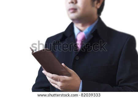 stock-photo-businessman-holding-a-book-i