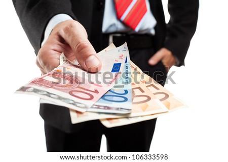 Businessman holding a bunch of money. Shallow deep of focus.