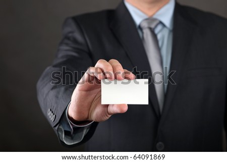 Businessman holding a business card.