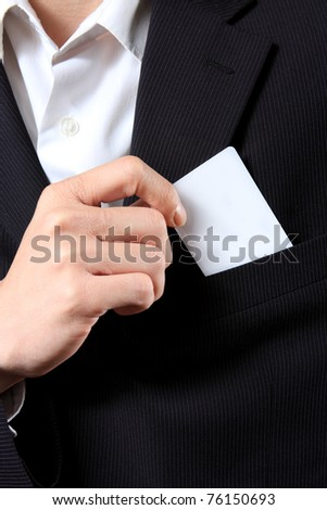 Businessman Holding a Card out of his suit pocket