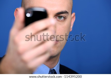 businessman holding a cell