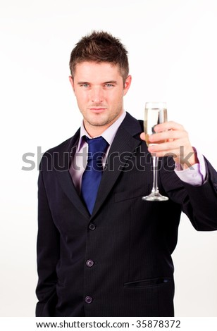Businessman holding a champagne glass with camera focus on the glass