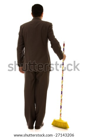businessman holding a cleaning broom (isolated on white)