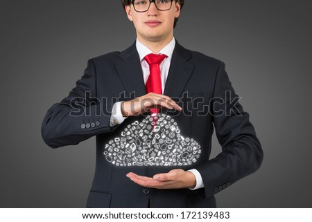 Businessman holding a data cloud