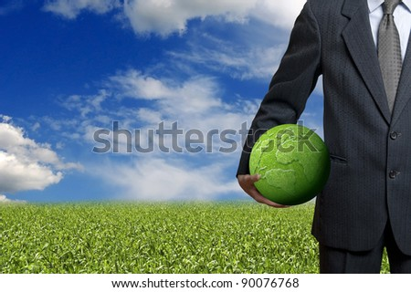 businessman holding a green earth