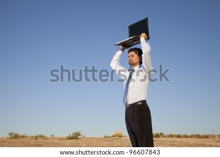 Businessman holding a laptop in outdoor