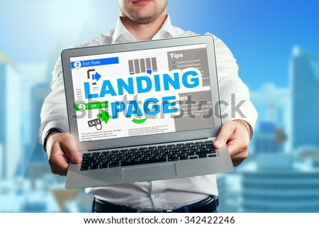 Businessman holding a laptop with an landing page. Business, technology, internet and networking concept. #342422246