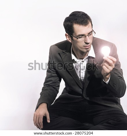 Businessman holding a light bulb - stock photo