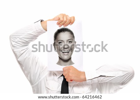 Businessman holding a piece of paper over his face with a happy woman on it