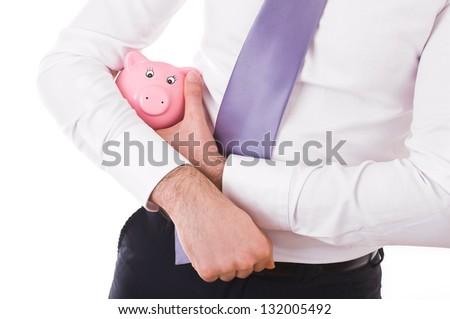 Businessman holding a piggy bank.