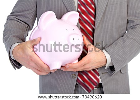 Businessman holding a piggy bank. Isolated over white background.