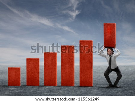 Businessman holding a red block of a business analysis
