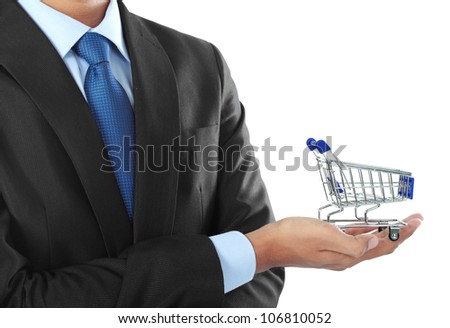 businessman holding a shopping cart isolated over white background