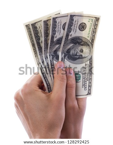 Businessman holding a stack of dollars and UAH