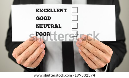 Businessman holding a survey check with multiple choice check boxes for excellent - good - neutral - poor ratings.
