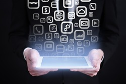 businessman holding a tablet pc with apps icons and text. Internet concept. business concept.