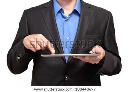 Businessman holding a tablet touch computer gadget and touches the screen - stock photo