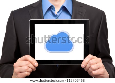 businessman holding a tablet touch computer gadget with the image of cloud