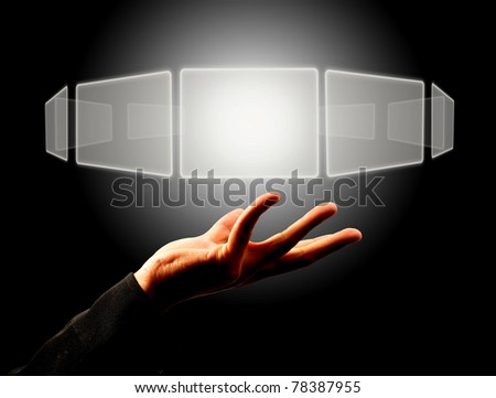 Businessman holding a touch screen button - stock photo