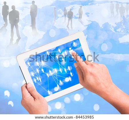 Businessman holding a touchpad pc and surfing in the social network
