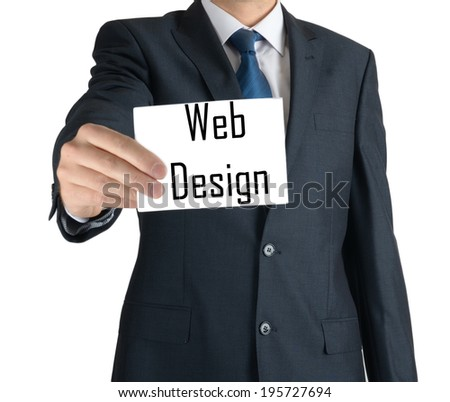 businessman holding a white sheet of paper with the inscription on white background: web design