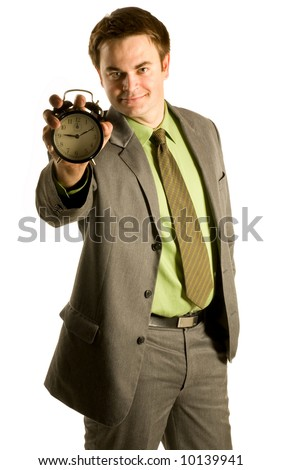 Businessman holding alarm clock on white