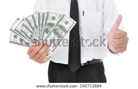 Businessman holding american dollars and showing thumb up, isolated on white background