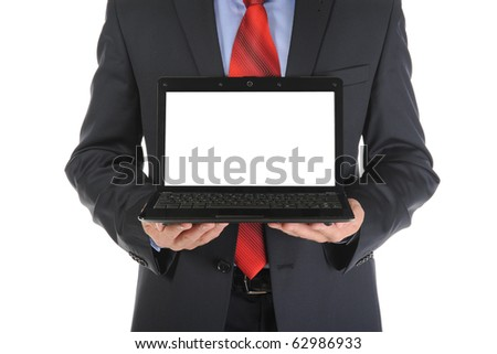 Businessman holding an open laptop. Isolated on white background - stock photo