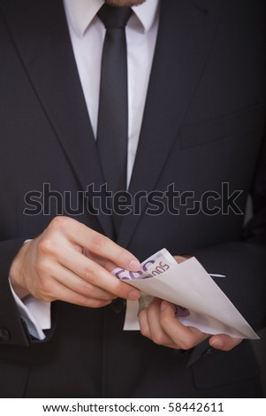 businessman holding and counting money in his hands