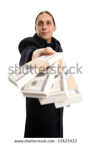 Businessman holding and giving stack of money for saving, focus on face of man - stock photo