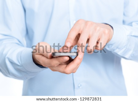 Businessman holding and touching screen on a mobile phone. Close-up photo.