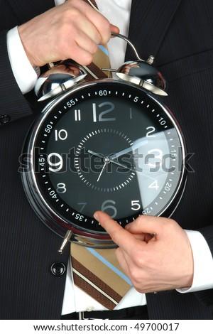 businessman holding big clock