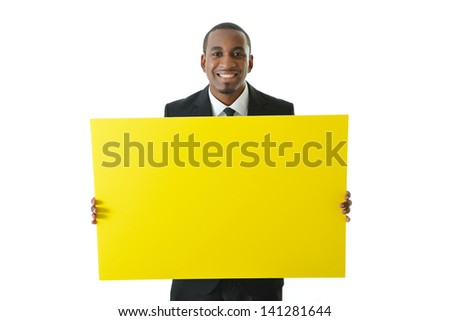 Businessman holding big yellow board to be filled in with ideas or concepts