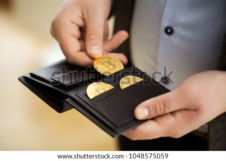 Businessman holding bitcoin.Golden bitcoin coins in man hands. Virtual currency. Crypto currency. New virtual money. Opened wallet.