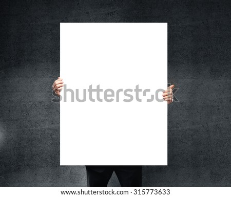 businessman holding blank poster in hand. #315773633
