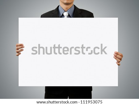 businessman holding blank sign