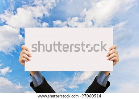 businessman holding blank sign and hand in sky