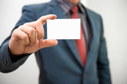 businessman holding blank visit card