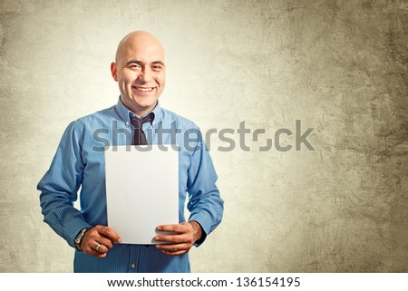 Businessman holding blank white paper as a document, cv or contract.