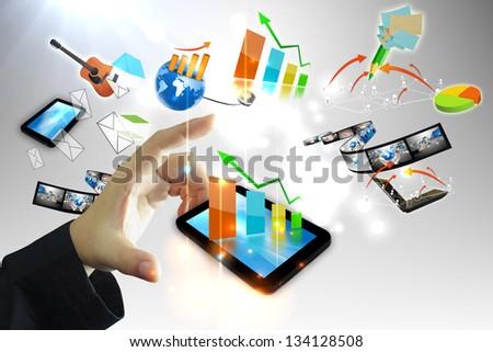 Businessman holding business graph