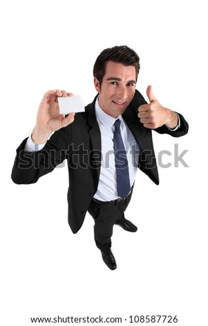 Businessman holding card and making OK gesture