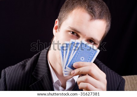 Businessman holding cards